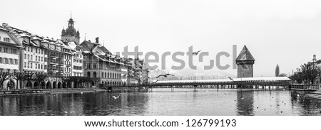 Panorama of Chapel Bridge, famous covered wooden bridge, Lucerne Switzerland.
