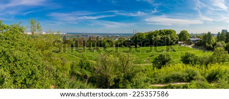 panorama of city landscape and nature. Kiev, Ukraine. Green trees, architecture, and blue river