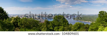 Panorama of city landscape and nature. Kiev, Ukraine. Green trees, architecture, bridges and blue river