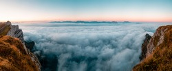 Panorama of cloud layer from mountain top over Swiss alps
