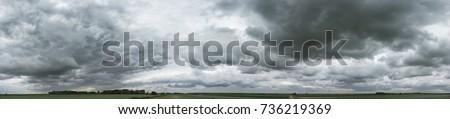 Panorama of cloudy gray sky