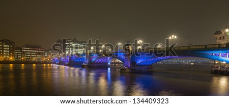 Panorama of colorful blackfriars bridge over the river Thames at dusk, beautifuuly lit in blue and purple In London, capital lof United Kingdom