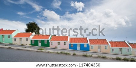 Panorama of colorful row homes. Panorama of colorful row homes build on a hill in Willemstad, Curacao, Netherlands Antilles.