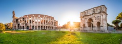 Panorama of Colosseum and Constantine arch at sunrise in Rome. Rome architecture and landmark. Rome Colosseum is one of the main attractions of Rome and Italy.