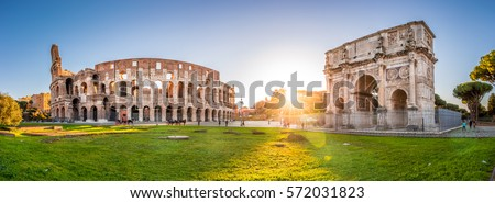 Panorama of Colosseum and Constantine arch at sunrise in Rome. Rome architecture and landmark. Rome Colosseum is one of the main attractions of Rome and Italy. #572031823