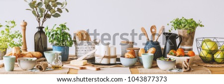 Panorama of dining table with fruit, butter, candles and olive oil