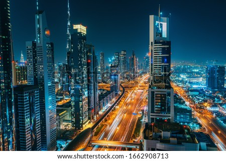 Panorama of Dubai downtown at night from above, United Arab Emirates.