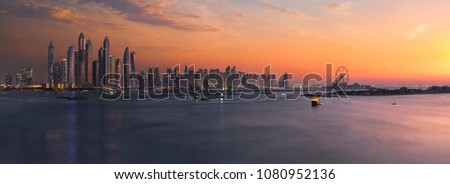 Panorama of Dubai Marina skyline at sunset