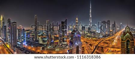 Panorama of Dubai skyline during sunset with shining traffic road, United Arab Emirates. #1116318386