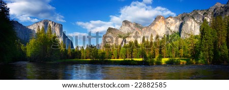 Panorama of El Capitan and the Cathedral Rocks/Bridalveil Falls with the Merced River flowing in front.