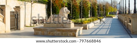 panorama of embankment with lions sculpture and spring tulips in the morning in Odessa in Ukraine #797668846