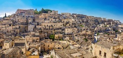 Panorama of famous Italian city Matera. Matera city in the region of Basilicata, in Southern Italy, is a complex of cave dwellings carved into the ancient river canyon.