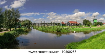 Panorama of famous Zaanse Schans village with windmills located near Amsterdam, Netherlands.