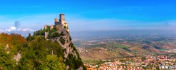 Panorama of First tower Guaita fortress in the city of San Marino of the Republic of San Marino and italian hills in sunny day