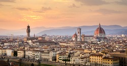 Panorama of Florence (Firenze) in Italy at sunset from Piazza Michelangelo including the cathedral of Santa Maria del Fiore (Duomo) and Palazzo Vecchio