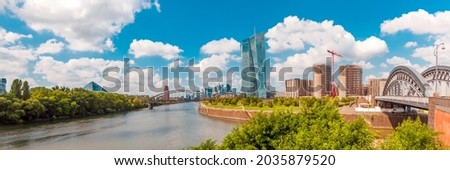 Panorama of Frankfurt am Main with skyline and River Main on a beautiful summer day. View to Frankfurt Ostend. Skyscraper buildings on construction site in Ostend and Bridge Honsellbrücke. Web banner