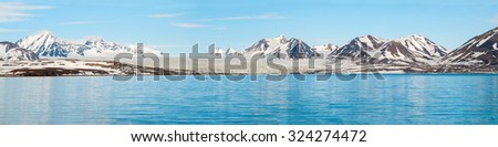 Panorama of glacier above the sea with the mountains behind, Svalbard, Norway #324274472