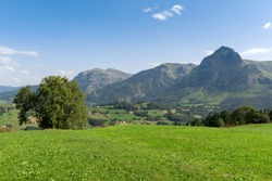 Panorama of Goierri from Lazkaomendi with Txindoki mountain as background, Basque Country, Spain