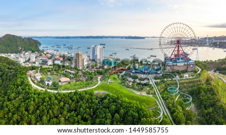 Panorama of Ha Long City, Vietnam, with Sun World Halong park and Bai Chay bridge. Near Halong Bay, UNESCO World Heritage Site. View from Cua Luc bay to Ha Long bay