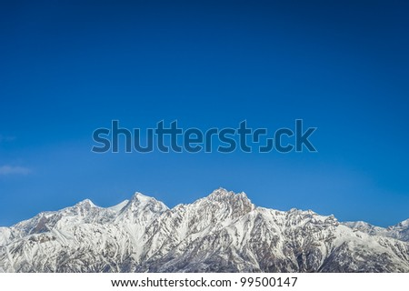 Panorama of Himalaya mountains with clear, blue sky, Nepal