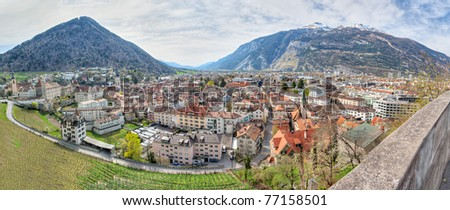 Panorama of historic city center with church, castle  and old houses surrounded by vinyards and mountains in Chur, Switzerland