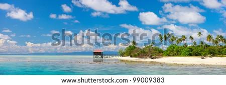Panorama of idyllic island and turquoise ocean water - stock photo
