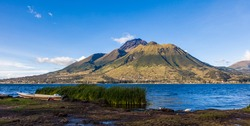 Panorama of Imbabura volcano, with blue sky and  San Pablo Lake