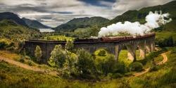 Panorama of Jacobite steam train on old bridge, Scotland