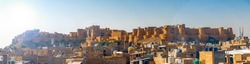 panorama of Jaisalmer Fort's massive yellow sandstone walls are a tawny lion colour during the day, fading to honey-gold as the sun sets. It is also known as the Sonar Quila or Golden Fort.