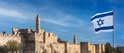 Panorama of Jerusalem's Citadel near the Jaffa Gate with Tower of David, ancient fortress walls and Israeli flag. Zion Mount with buildings of Dormition Abbey and bell tower on background.