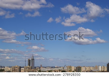 Panorama of Kiev with clouds in the blue sky, shooting from the top point