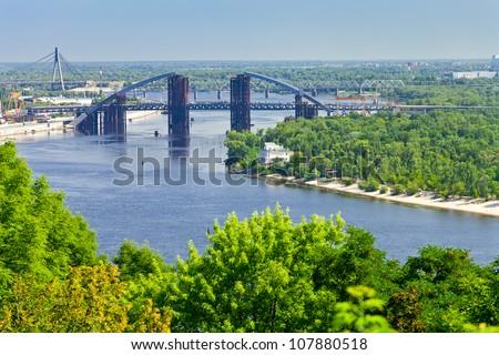 panorama of Kiev with Podilsko-Voskresenskyi Bridge on Dnieper River in Kiev, Ukraine