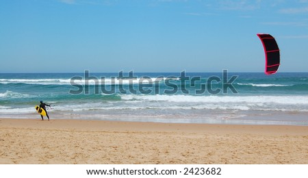 Panorama of kite surfer on a beach