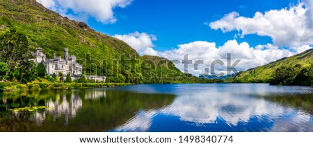 Photo of  Panorama of Kylemore Abbey, beautiful castle like abbey reflected in lake at the foot of a mountain. Benedictine monastery, in Connemara, Ireland