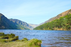 Panorama of Lake Lough Tay or The Guinness Lake. County Wicklow, Wicklow Mountains National Park, Ireland.