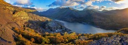 Panorama of Llyn Padarn and Llanberis and snowdon in the background, Wales Uk.