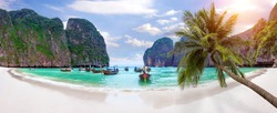 Panorama of Long boat and blue water at Maya bay in Phi Phi Island, Krabi Thailand.