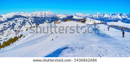 Panorama of long slopes of the Schmitten mountain with comfortable pistes, that attract the skiers and boarders to visit Zell am See Alps resort, Austria. #1436862686