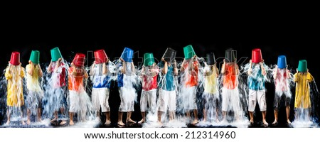 Panorama of man pour a bucket of ice topped their head on a black background.