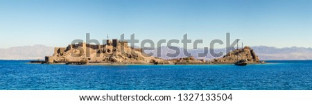 Panorama of medieval Castel of Saladin on the Pharaoh's Island in the Gulf of Aqaba. Old fortress of Sultan Salah El Din in Taba - ancient landmarks of an arabic culture on Sinai Peninsula, Egypt. Stock fotó ©