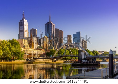 Panorama of Melbourne CBD with Skyscrapers, Evan Walker Bridge and Yarra River against clear sky. High Resolution Photography.