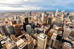 Panorama of Melbourne's city center from a high point. Australia. Beautiful panorama of skyscrapers in the city center and suburbs to the horizon. Sunset and blue clouds.