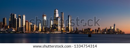 Panorama of Midtown Manhattan and Lower Manhattan at dusk. Blue hour photograph of the new New York skyline. #1334754314