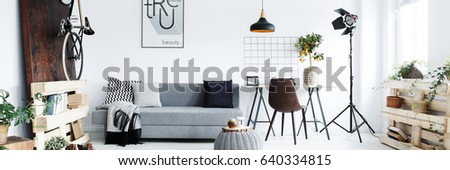 Panorama of minimalist apartment for man with hipster furniture #640334815