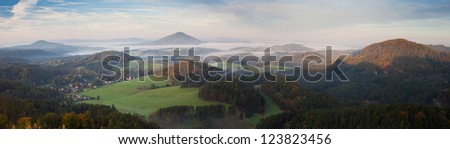 panorama of misty landscape in morning sun