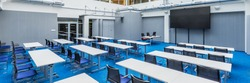 Panorama of modern and stylish university lecture hall in grey and blue