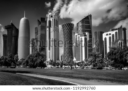Stock Photo Panorama of modern skyscrapers in Doha, Qatar monochrome photography.