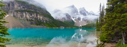 Panorama of Moraine lake with fog and mountain in Banff, Alberta