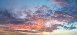 Panorama of morning sunrise with a perfect colorful sky and heavenly clouds.