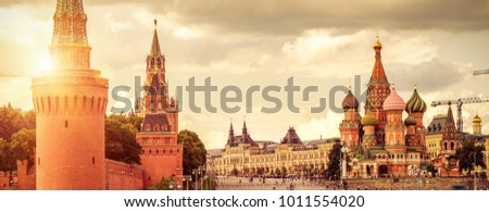 Panorama of Moscow Kremlin and St Basil's Cathedral on Red Square in Moscow, Russia. This place is the main tourist attraction of Moscow. Beautiful panoramic view of the Moscow centre in sun light. #1011554020